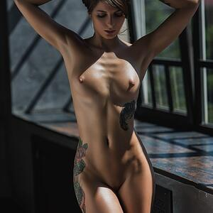 Picture tagged with: Brunette, Tattoo, Tummy