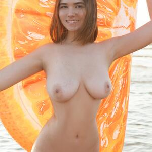 Picture tagged with: Busty, Brunette, Beach, Boobs, Eva Elfie, Smiling, Tummy