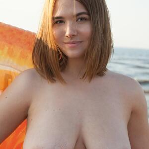 Picture tagged with: Busty, Brunette, Beach, Boobs, Eva Elfie
