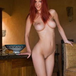 Picture tagged with: Femjoy, Redhead, Boobs, Tummy