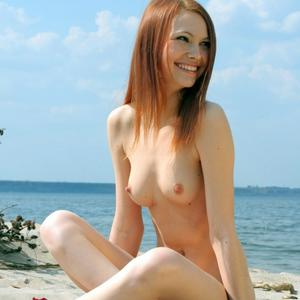 Picture tagged with: Skinny, Redhead, Beach, Small Tits