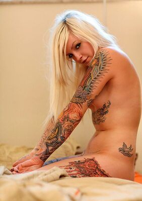 Picture tagged with: Blonde, Tattoo