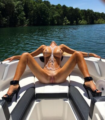 Picture tagged with: Boat, Boobs, Nature, Piercing, Pussy
