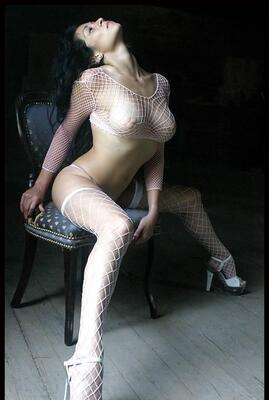 Picture tagged with: Brunette, Boobs, Fish Net, Tummy