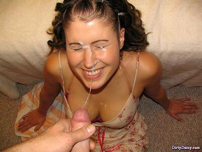 Picture tagged with: Brunette, Cumshot, Facial, Smiling