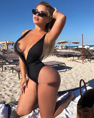 Picture tagged with: Anastasia Kvitko - Анастасия Квитко, Blonde, Busty, Beach, Bikini, Boobs, Celebrity - Star