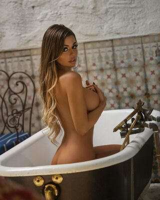 Picture tagged with: Busty, Brunette, Bath, Boobs, Juli Annee