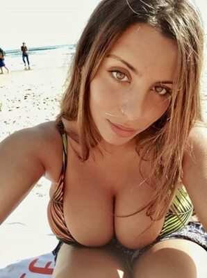 Picture tagged with: Brunette, Busty, Beach, Bikini, Boobs, Eyes