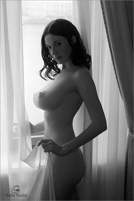 Picture tagged with: Black and White, Brunette, Busty, Boobs