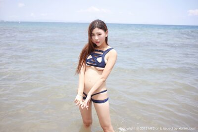 Picture tagged with: Skinny, Asian, Beach, Bikini, Shy