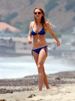 Picture tagged with: Skinny, Redhead, Bikini, Celebrity - Star, Lindsay Lohan, Piercing